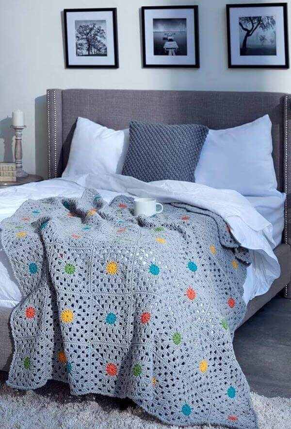 Gray bedspread with blue polka dots for neutral bedroom