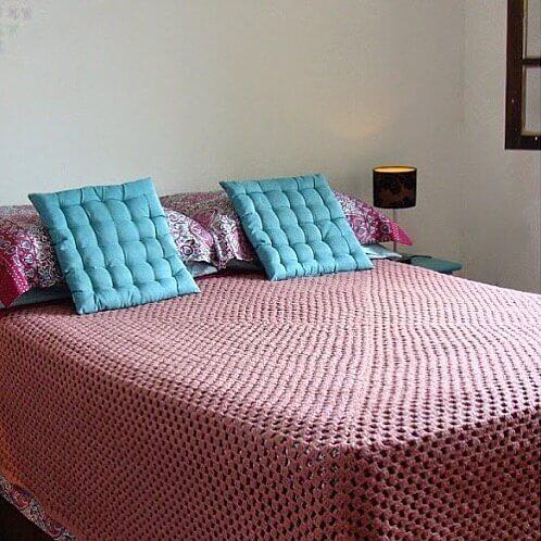 Pink crochet bed coverlet