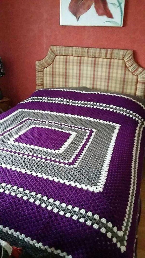 Purple crochet bedspread