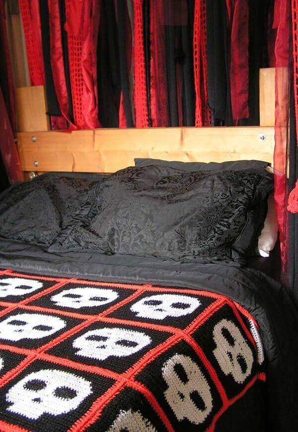 Crochet quilt with skull graphic