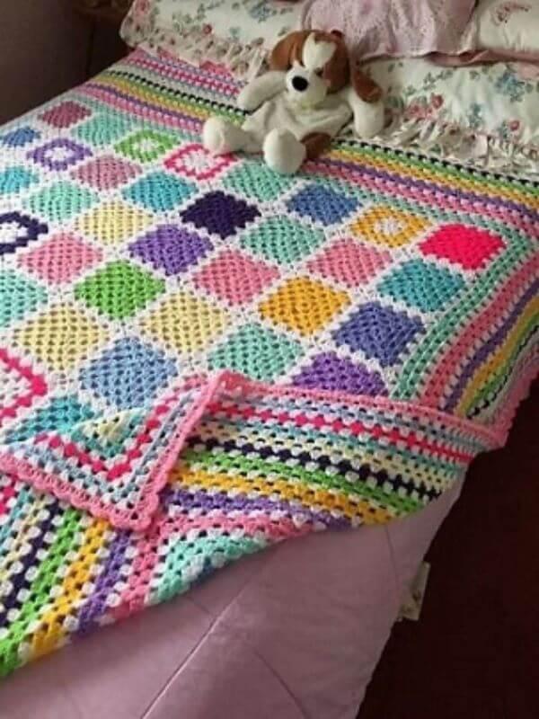 Colorful crochet bedspread in children's room