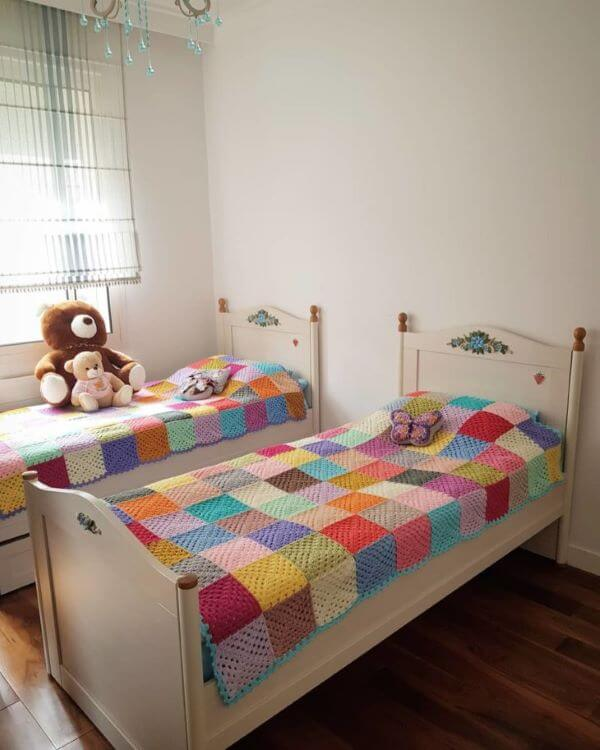 Shared room decorated with the same colorful bedspread