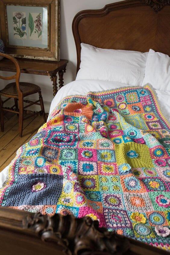 Colorful crochet bedspread for rustic bedroom