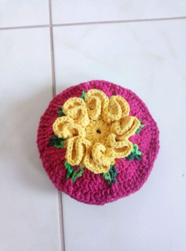 Crochet door weight with colorful flower