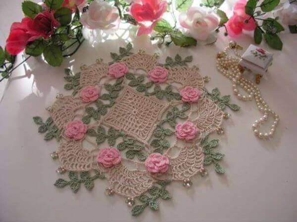 Crochet flowers and leaves in centerpiece