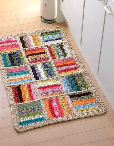 Colorful rectangular crochet kitchen rug Photo by Muito Chique