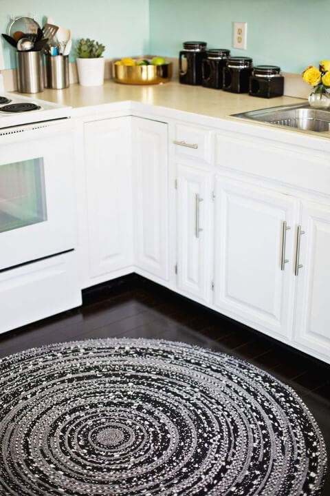 Large round black and gray crochet kitchen rug Photo by Home Deco