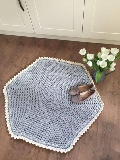Blue hexagon crochet kitchen rug with white border Photo by Love Crochet
