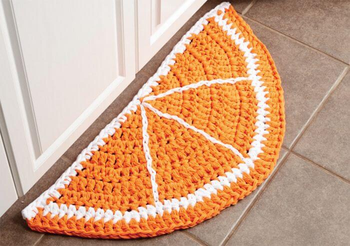Crochet kitchen rug in orange shape Photo by Mary Maxim