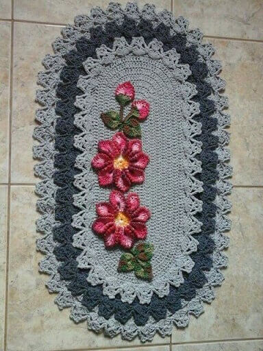 Gray oval crochet kitchen rug with two flowers