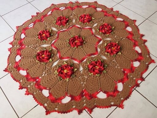 Crochet brown kitchen rug with red flowers