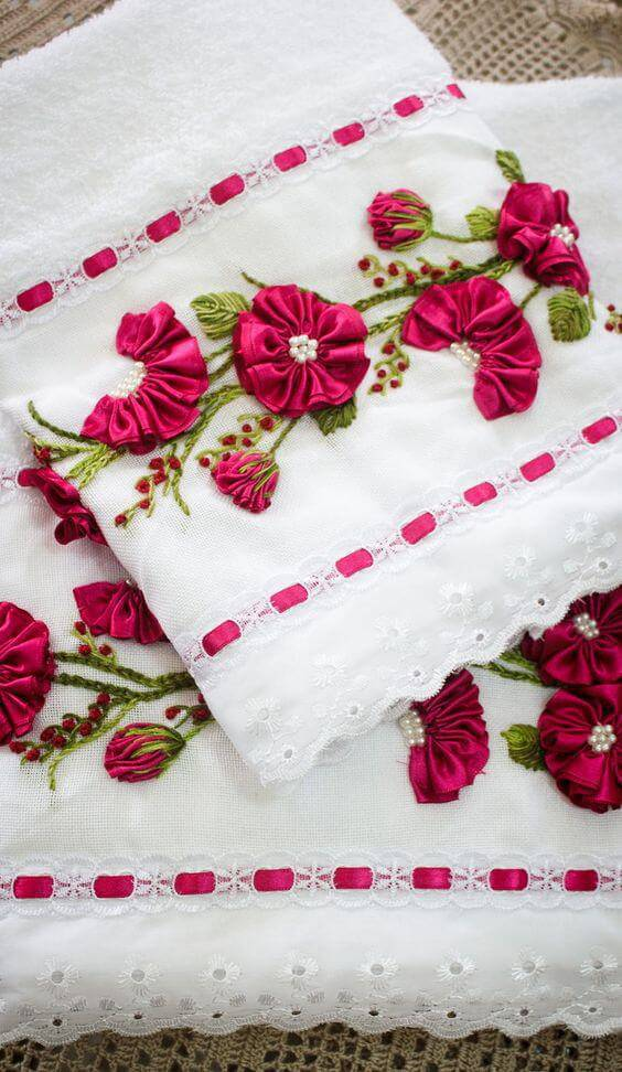 Bathroom towel decorated with satin ribbon flower