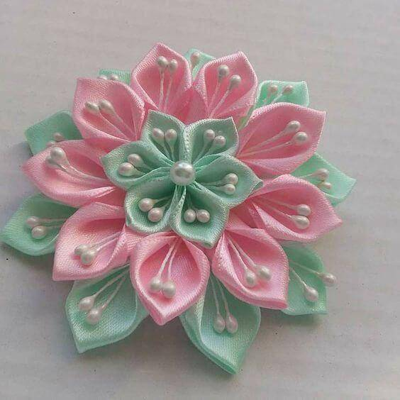 Green and pink flower with pearls