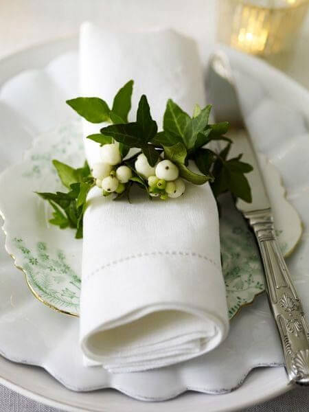 White fabric napkin with plant ring