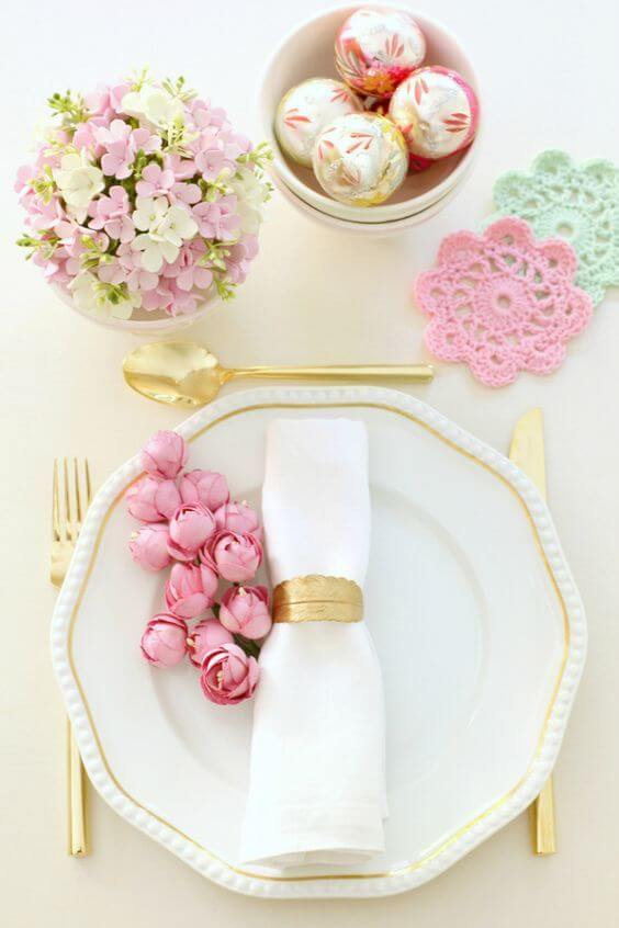 Simple and beautiful fabric napkin with pink flowers on the table