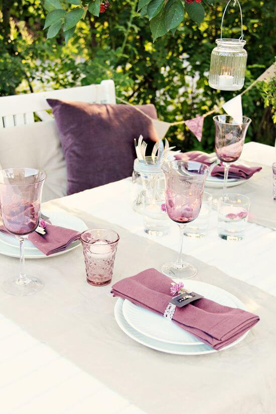 Party table with purple fabric napkin