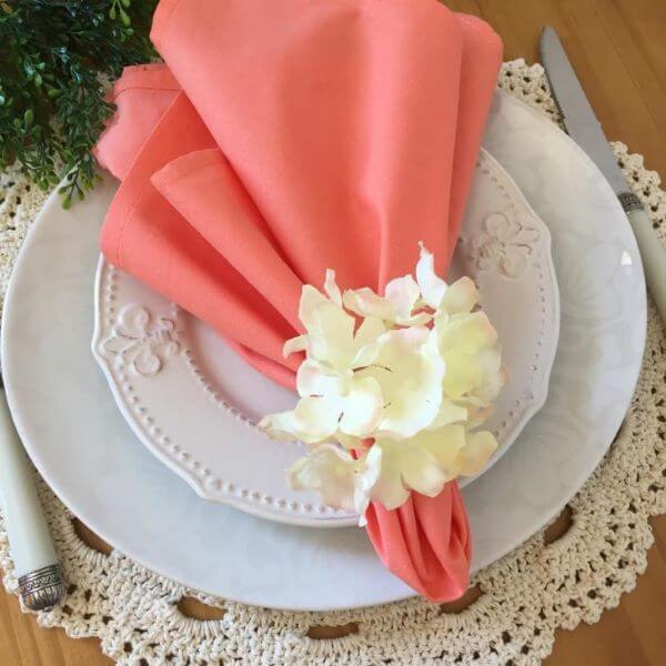 Coral fabric napkin with off white napkin holder