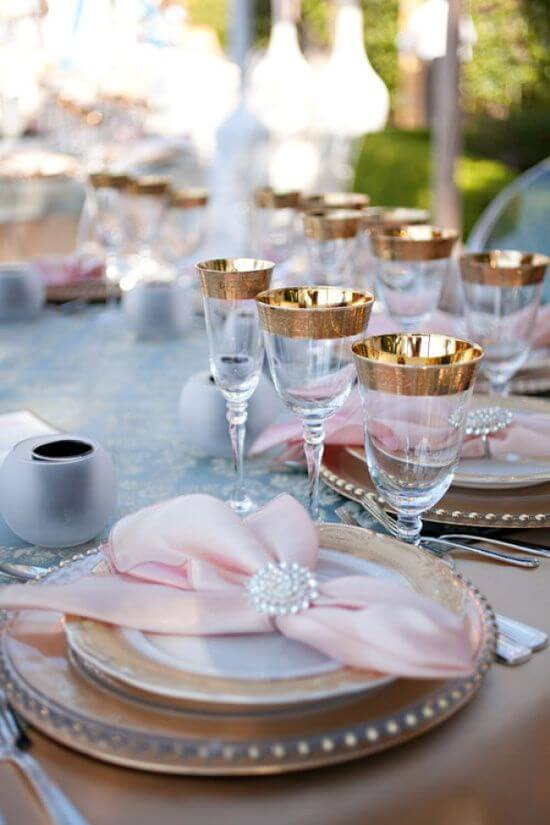 Pink fabric napkin with golden decoration
