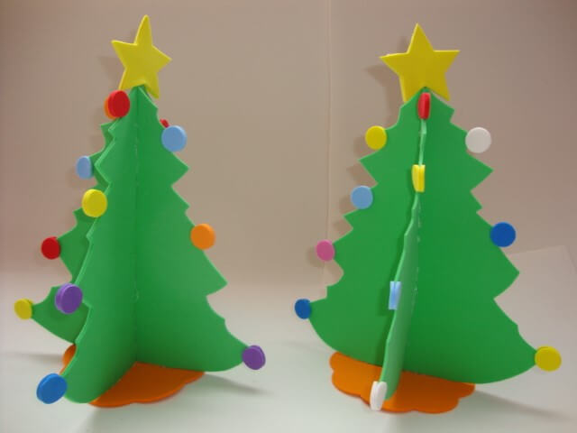 Christmas ornaments on EVA table trees with colorful polka dots