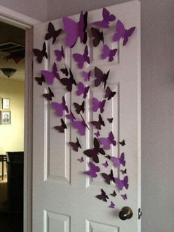 Purple paper butterflies on children's room door