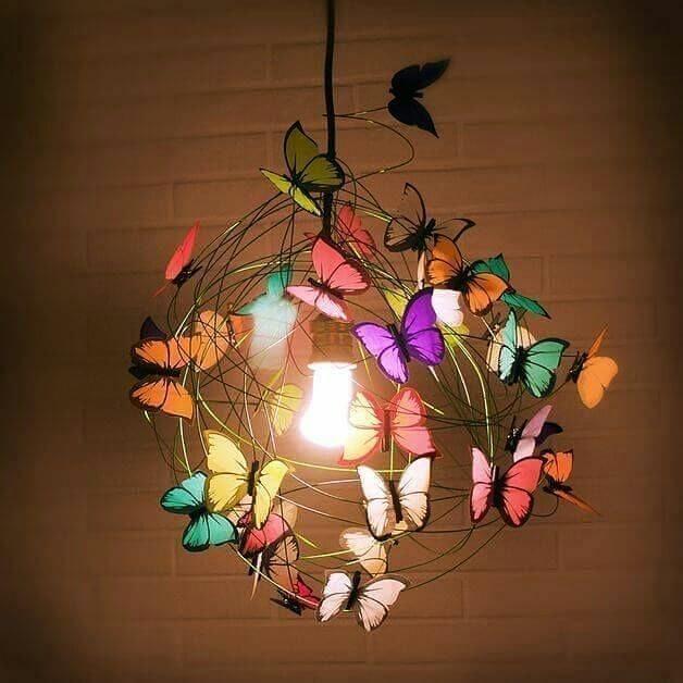 Colorful paper butterflies in the bedroom chandelier