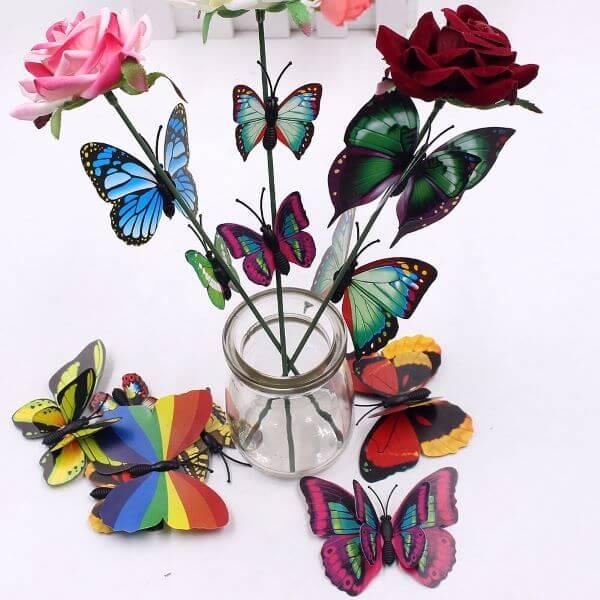 Paper butterflies on flowers