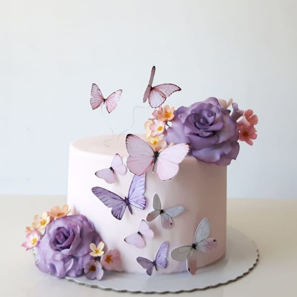 simple birthday cake with paper butterflies