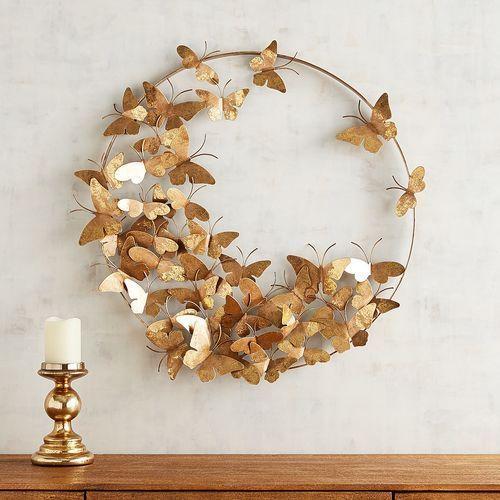 Golden paper butterflies in the dining room decor