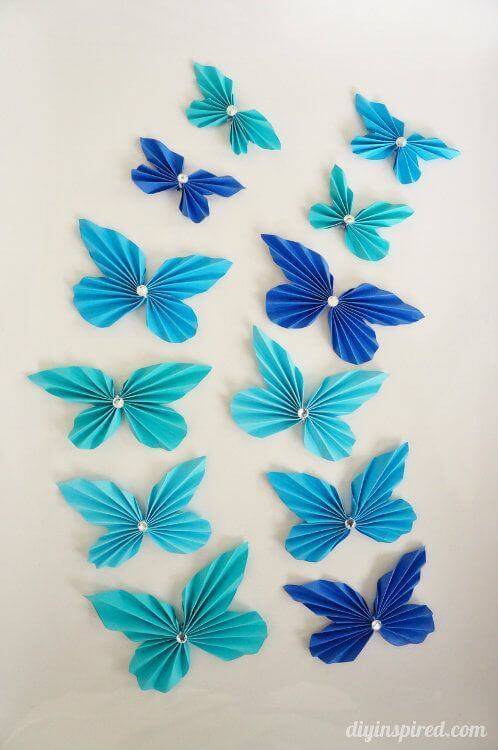 Blue paper butterflies with stones
