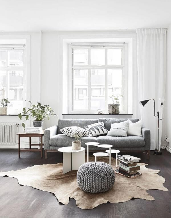 Modern gray living room with crochet puff