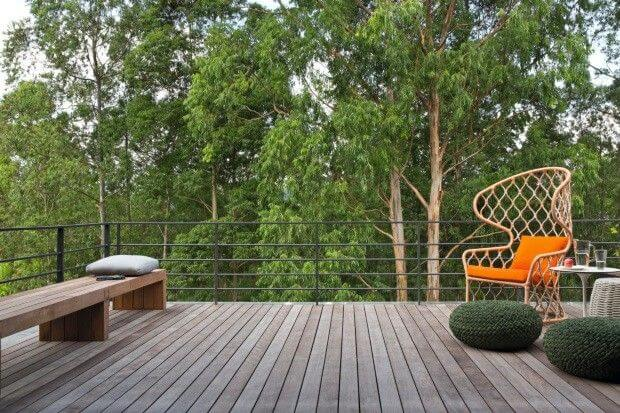 Terrace decoration with orange chair and green crochet puff