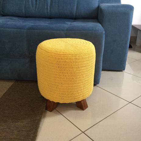 Yellow crochet pouf