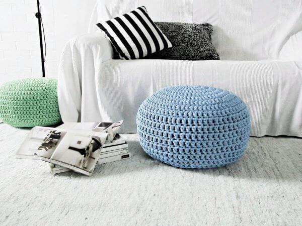 Blue crochet pouf in white room