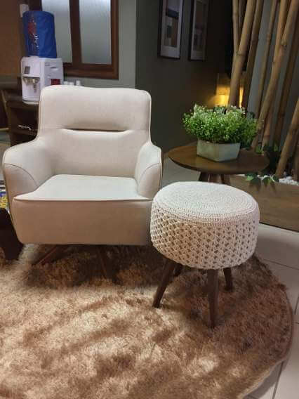 White crochet pouf matching the armchair