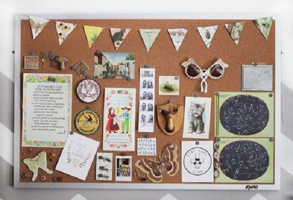 Cork board with white frame decorated in a fun way