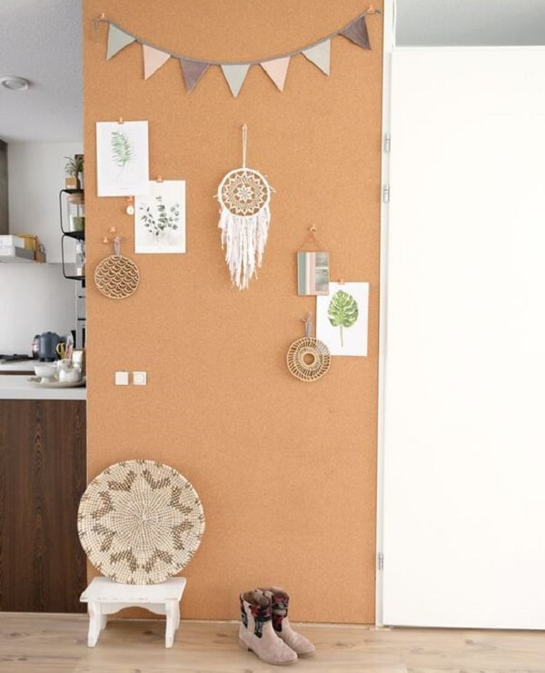 The wall of the room was covered with a large cork board
