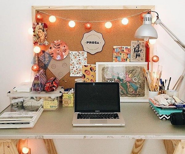 Workbench with cork board illuminated with flasher