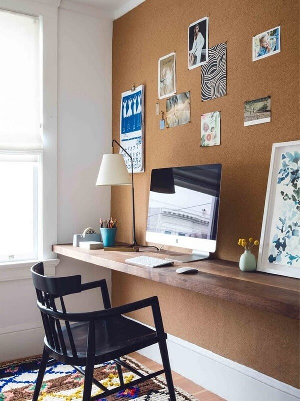 To save on home office setup, choose a corkboard on the wall