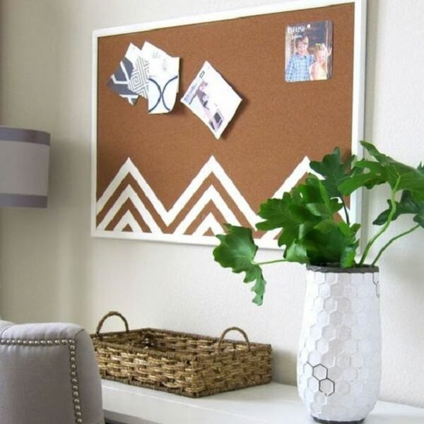 Cork board with white frame harmonizes with the decor of the environment