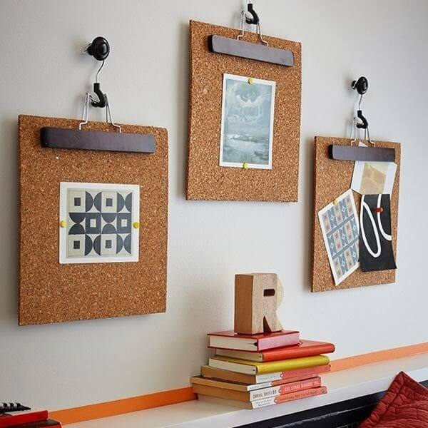 Cork board fixed with hooks on the wall