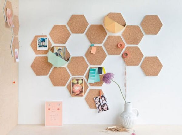 Frame made of cork cut in geometric shapes form a beautiful set on the wall