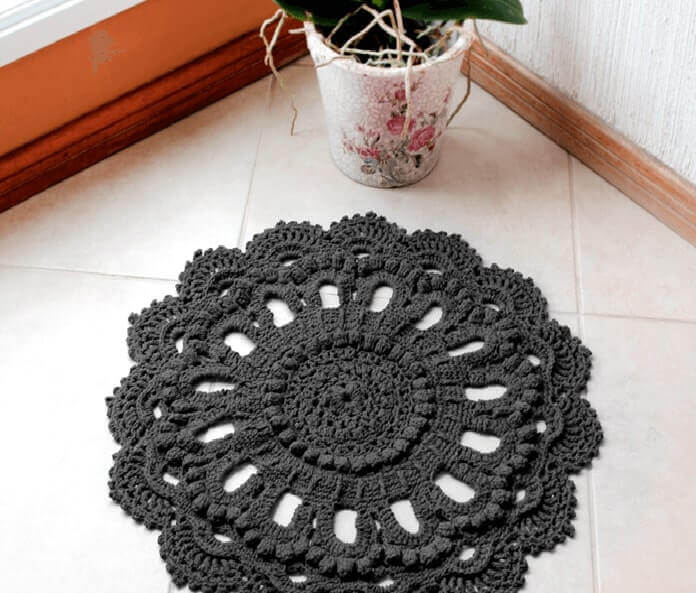 Graphic gray round crochet rug