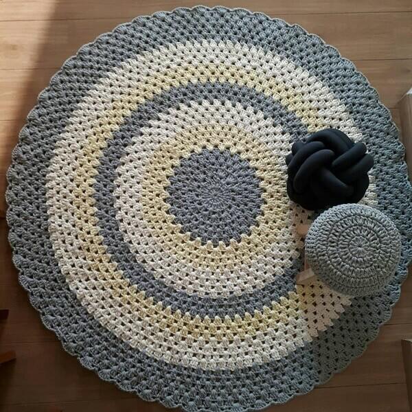 Round gray and yellow crochet rug