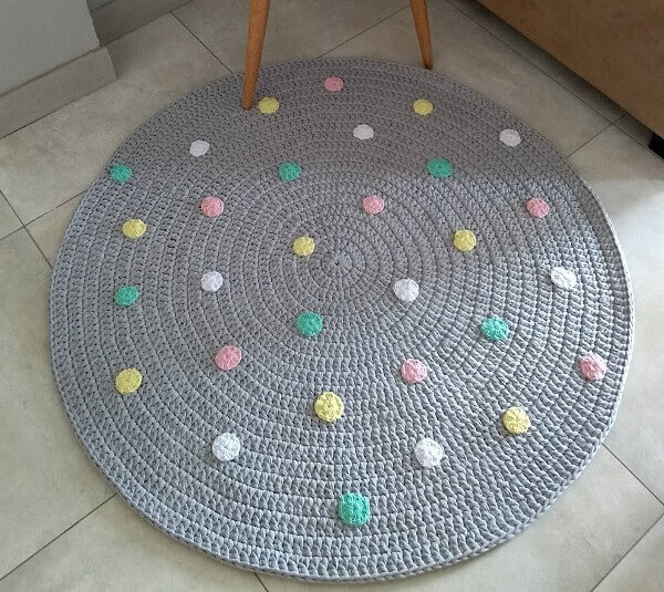 Gray round crochet rug.