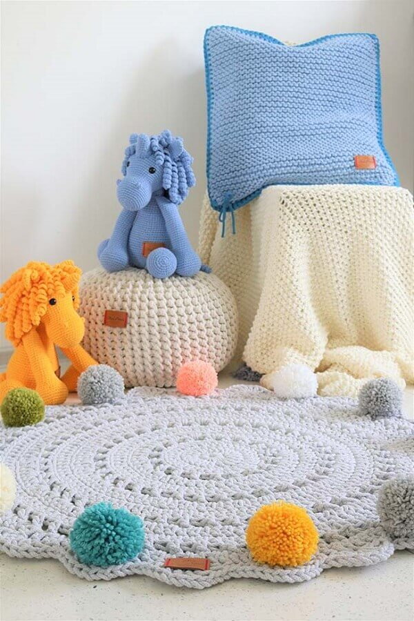 Round crochet rug with pompom for baby room