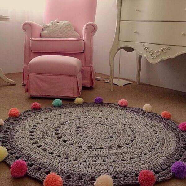 Round crochet rug with pompoms