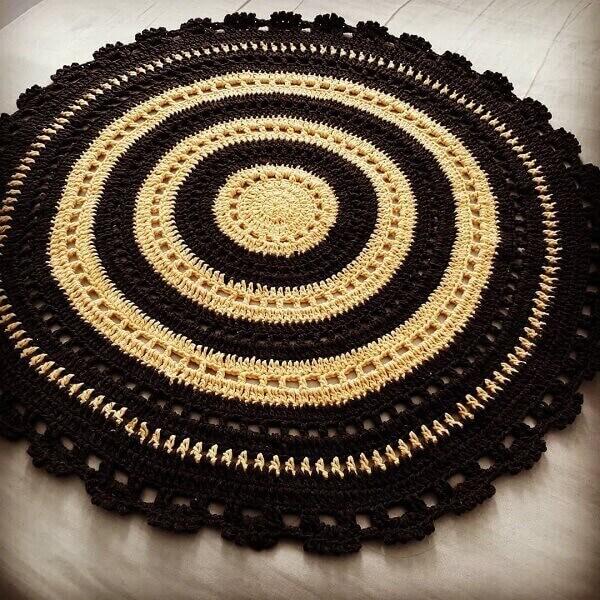 Round crochet rug in dark tones
