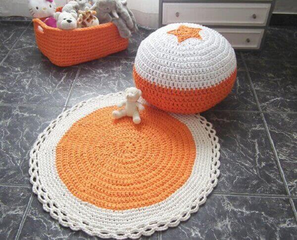 Orange and white round crochet rug
