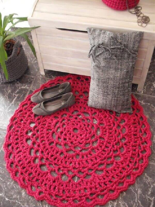 Red round crochet rug in decoration