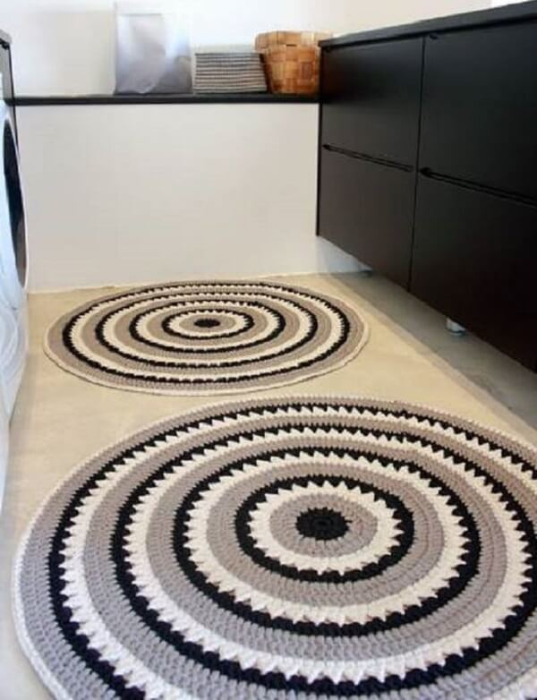 Two crochet rugs complement the space's decor